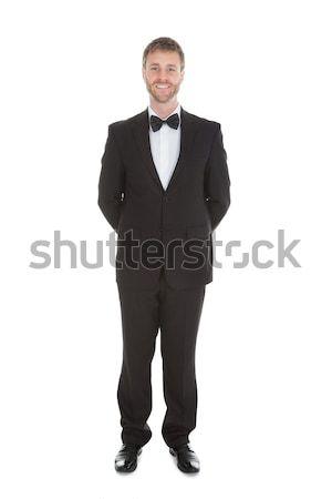 официант Постоянный рук за назад Сток-фото © AndreyPopov