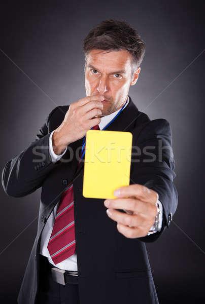 Empresario amarillo tarjeta retrato maduro Foto stock © AndreyPopov