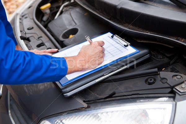 Mechanic Maintaining Car Records Stock photo © AndreyPopov