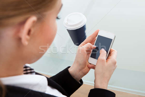 Businesswoman Using Cellphone Stock photo © AndreyPopov
