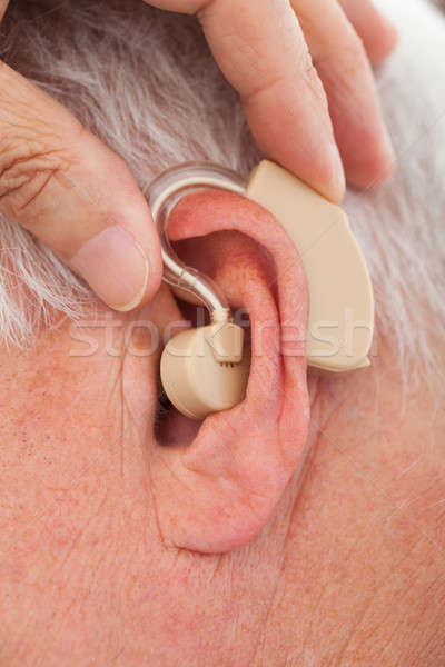 Orvos hallókészülék idős fül kép kéz Stock fotó © AndreyPopov
