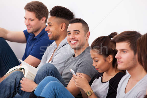 Happy College Student Sitting With Classmates Stock photo © AndreyPopov