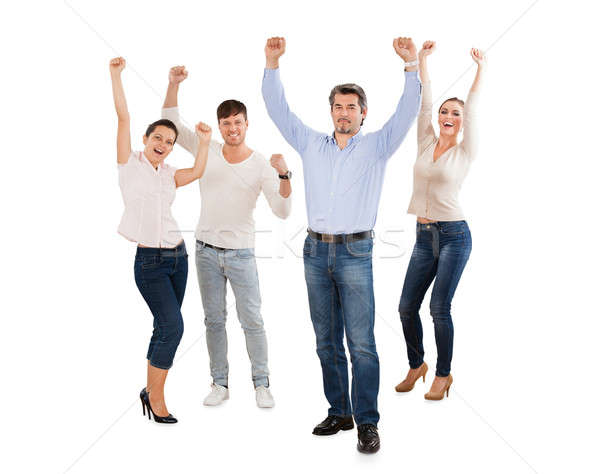 Successful Businesspeople With Arms Raised Stock photo © AndreyPopov