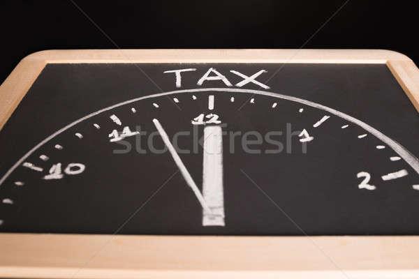Imposto tempo desenho lousa escrito pequeno Foto stock © AndreyPopov