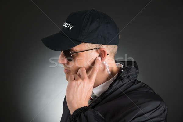 Secret Agent Listening To Earpiece Stock photo © AndreyPopov