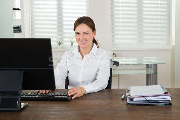 Handicapped Businesswoman Working On Computer Stock photo © AndreyPopov