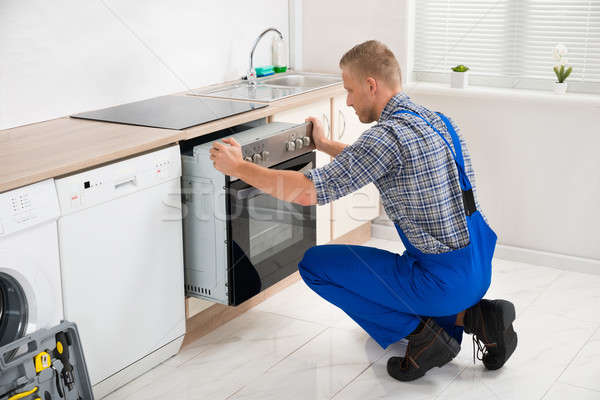 Repairman Repairing Oven Stock photo © AndreyPopov