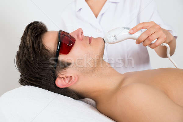 Man Receiving Laser Hair Removal Treatment Stock photo © AndreyPopov