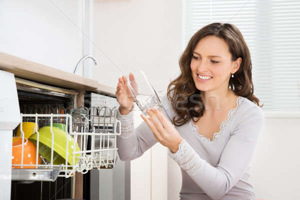 Woman Taking Drinking Glass From Dishwasher Stock photo © AndreyPopov