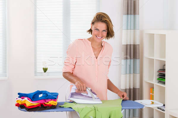 Woman Ironing Clothes Stock photo © AndreyPopov