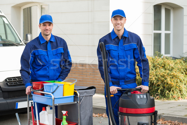 Happy Janitors Standing Against Truck Stock photo © AndreyPopov