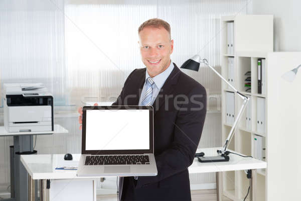 Businessman Showing Laptop With Blank Screen Stock photo © AndreyPopov