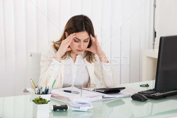 Depressed Businesswoman Calculating Invoice Stock photo © AndreyPopov