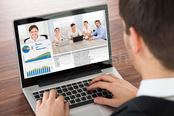 Businessman Video Conferencing On Laptop Stock photo © AndreyPopov