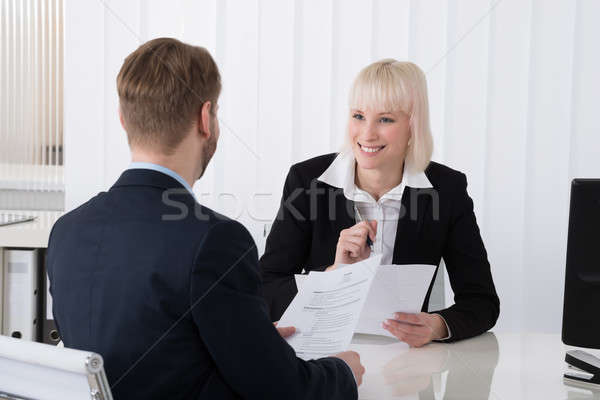 Businesswoman Discussing Over Resume With Male Candidate Stock photo © AndreyPopov