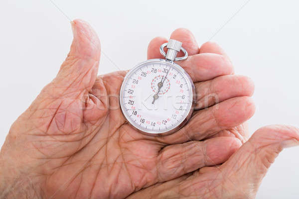 Senior Woman Holding Stop Watch Stock photo © AndreyPopov