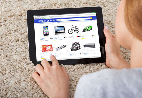Close-up Of Woman Shopping On Digital Tablet Stock photo © AndreyPopov