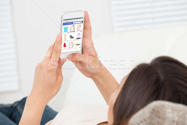 Woman Doing Online Shopping On Mobilephone Stock photo © AndreyPopov