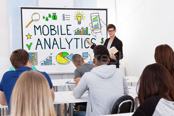Male Teacher Teaching Mobile Analytics To Students Stock photo © AndreyPopov