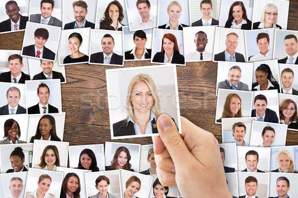 Személy kéz kiválaszt jelölt fotó magasról fotózva Stock fotó © AndreyPopov