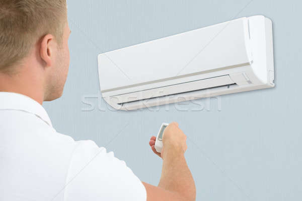 Man Using Air Conditioner Stock photo © AndreyPopov