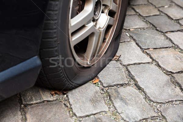 Sérült autógumi autó közelkép út utca Stock fotó © AndreyPopov