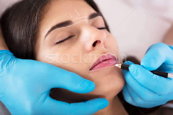 Cosmetologist Applying Permanent Make Up Stock photo © AndreyPopov