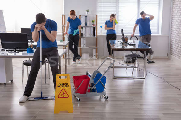 Tired Janitors In The Office Stock photo © AndreyPopov