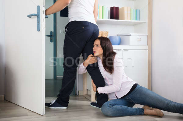 Woman Stopping The Man From Leaving Her Stock photo © AndreyPopov