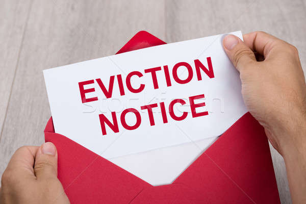 Person Holding Eviction Notice In Envelope Stock photo © AndreyPopov