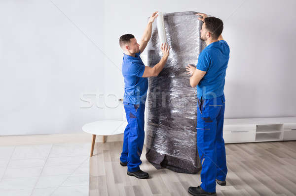 Two Male Movers Packing Furniture Stock photo © AndreyPopov