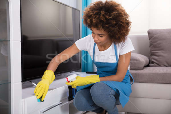Janitor Cleaning Furniture With Sponge Stock photo © AndreyPopov