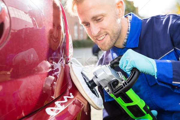 Male Worker Polishing Car Stock photo © AndreyPopov
