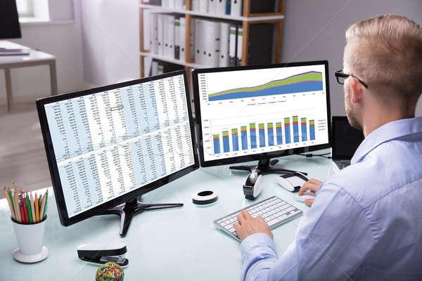 Businessman Analyzing Graph On Computer Stock photo © AndreyPopov