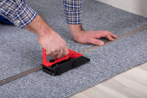 Carpet Fitter Installing Carpet With Tool Stock photo © AndreyPopov