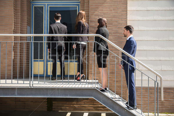 Stock photo: Businesspeople Standing Outside Office Building