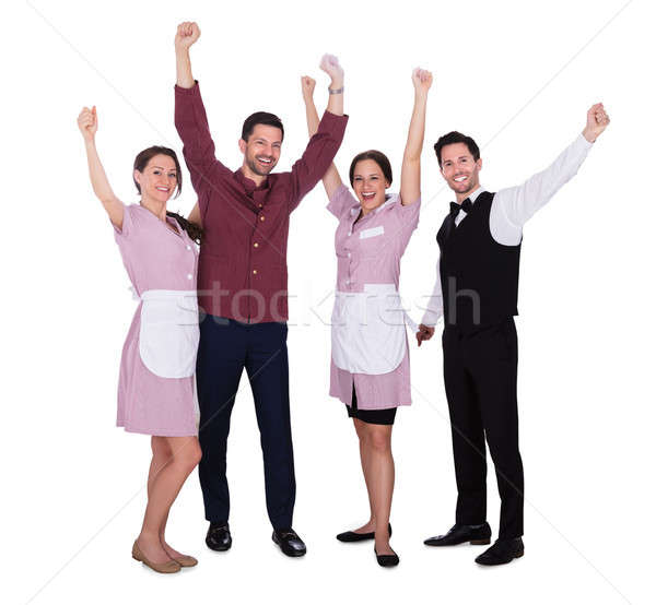 Happy Staff Raising Their Arms Stock photo © AndreyPopov
