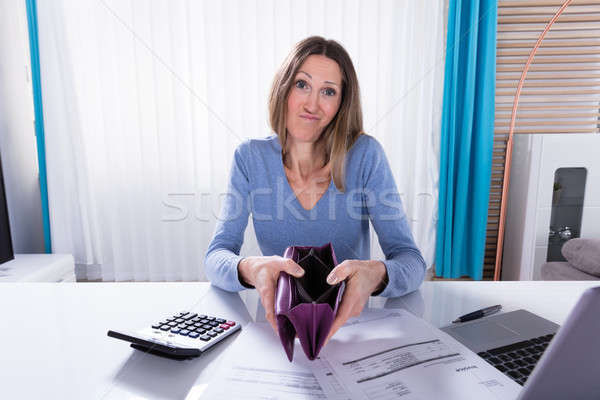 Mature Woman Showing Her Empty Purse Stock photo © AndreyPopov