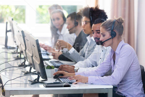 Customer Service Executives Working In Call Center Stock photo © AndreyPopov