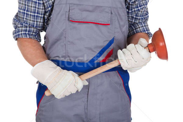 Happy plumber holding plunger Stock photo © AndreyPopov