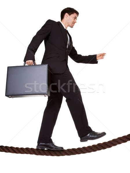Businessman walking a tightrope Stock photo © AndreyPopov