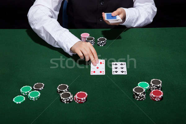 Croupier dealing cards Stock photo © AndreyPopov