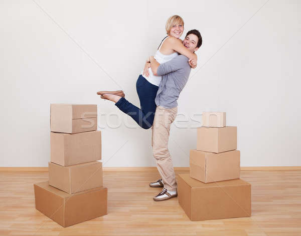 Happy young couple in new home Stock photo © AndreyPopov