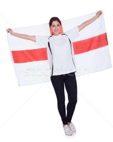 Csinos nő tart angol zászló portré boldog izolált Stock fotó © AndreyPopov