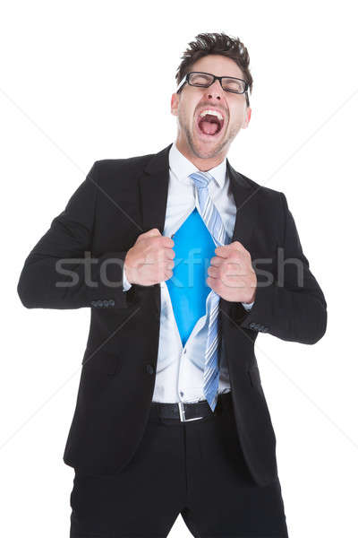 Businessman Tearing Apart His Suit Stock photo © AndreyPopov