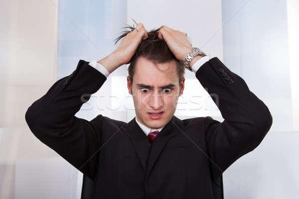 Confundirse empresario pelo jóvenes escritorio Foto stock © AndreyPopov