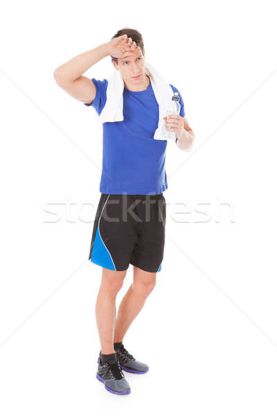 Young Athlete Holding Water Bottle Stock photo © AndreyPopov