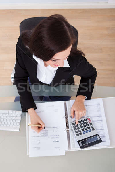Happy Businesswoman Calculating Tax Stock photo © AndreyPopov