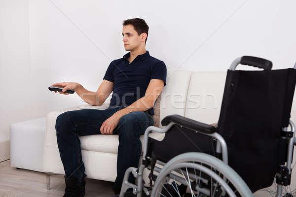 Fogyatékos férfi távirányító tv nézés fiatal fogyatékos Stock fotó © AndreyPopov