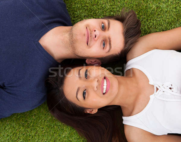 Young Couple Lying On Grass Stock photo © AndreyPopov